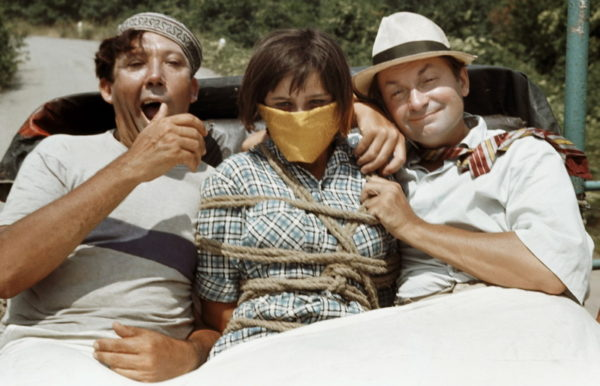 """Left to right: actors Yury Nikulin as the Booby, Natalya Varlei as Nina, and Georgy Vitsin as the Coward in the film """"Kidnapping Caucassian Style, or Shurik's New Adventures"""" by Leonid Gaidai."""